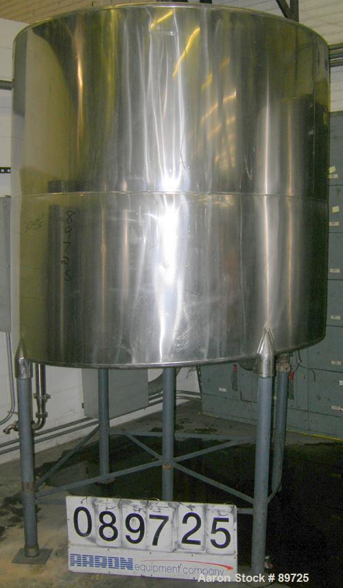 """USED: Tank, 825 gallon, 304 stainless steel, vertical. 64"""" diameter x 60"""" straight side, flat top, sloped bottom. Side botto..."""