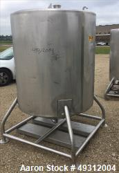 "Used- Tank, 500 Gallon, Stainless Steel, Vertical. Approximate 52"" diameter x 54"" straight side, flet top, coned bottom. Ope..."