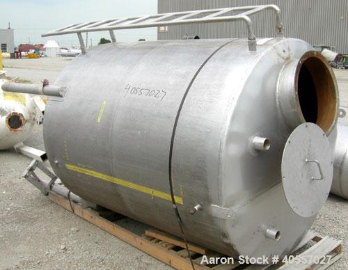"""Used- Tank, 900 Gallon, 304 Stainless Steel, Vertical. Approximately 60"""" diameter x 72"""" straight side. Coned top and bottom...."""