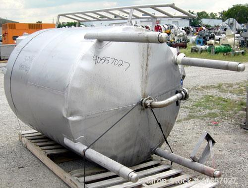"Used- Tank, 900 Gallon, 304 Stainless Steel, Vertical. Approximately 60"" diameter x 72"" straight side. Coned top and bottom...."