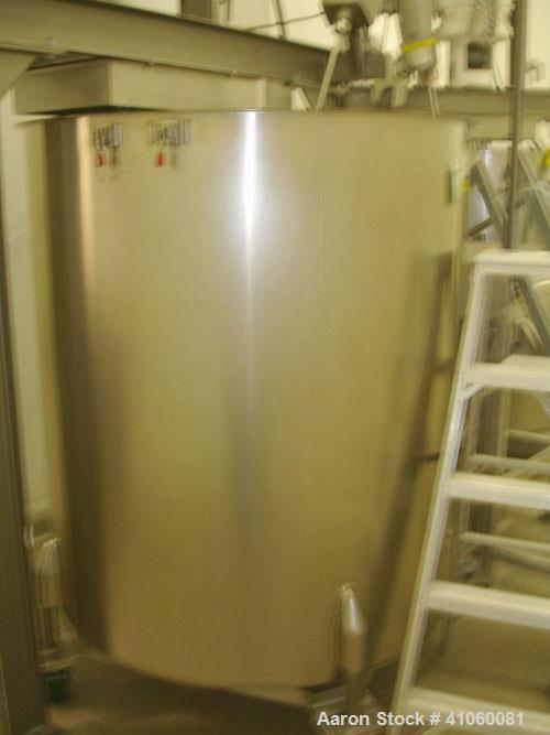 "Used- Tank, 500 Gallon, Stainless Steel. 50"" diameter x 64"" straight side, open top, flat bottom."