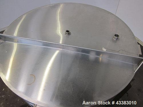 """Used- Tank, 580 Gallon, 304 Stainless Steel, Vertical. Approximate 62"""" diameter x 45"""" straight side, flat top with a bolt on..."""