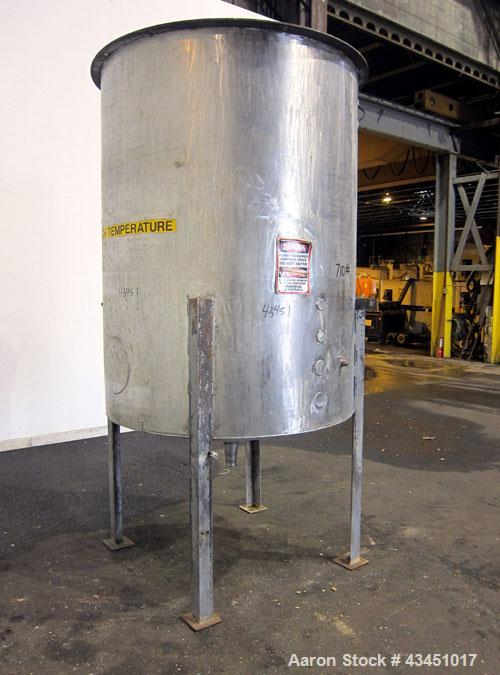 "Used- Tank, 750 Gallon, 304 Stainless Steel, Vertical. Approximate 55"" diameter x 72"" straight side. Open top, no cover, con..."