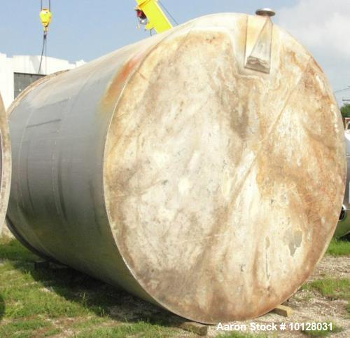 "Used- Used- 11,900 Gallon Vertical Stainless Steel Tank. Interior dimensions 140"" diameter x 175"" tall, open top, sloped bot..."