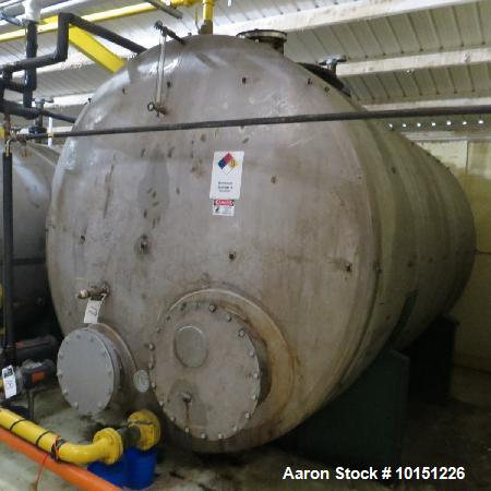 """Used- 5,375 Gallon Capacity, Horizontal Stainless Steel Tank. 8'5"""" in diameter x 12'8"""" long. Dished on both ends."""