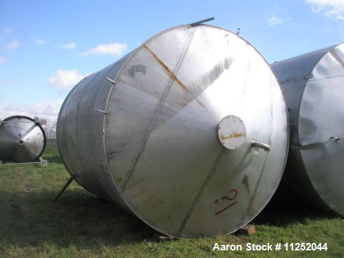 "Used- 13,000 Gallon Capacity, Vertical Tank, Stainless Steel Construction. Measures 12' 4"" diameter x 15' straight side. Fla..."