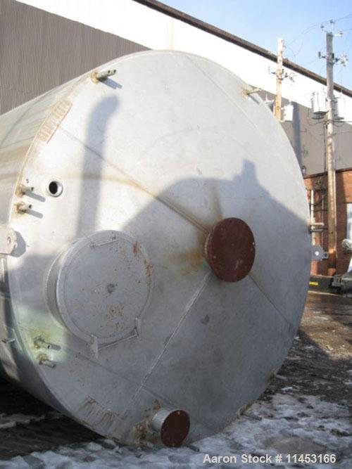 "Used-15,000 Gallon Stainless Steel Tank, approximately 10'6"" diameter x 23' straight side, slight cone top, flat bottom."