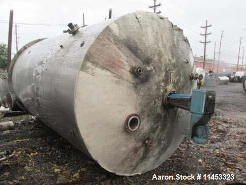 """Used- 12,000 Gallon, 304 Stainless Steel Tank. 12' diameter x 16' straight side; 4' carbon steel skirt. Dished ends, 24"""" sid..."""