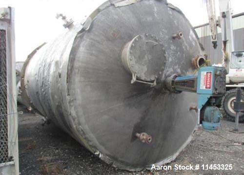 "Used- 12,000 Gallon Stainless Steel Tank. 12' diameter x 16' straight side. 4' carbon steel skirt; dished ends. 24"" side bot..."