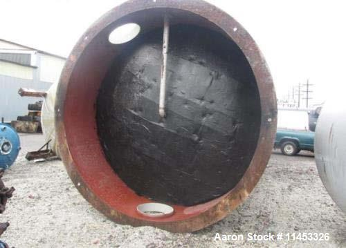 "Used- 12,000 Gallon 304 Stainless Steel Tank. 12' diameter x 16' straight side. 4' carbon steel skirt, dished ends, 24"" side..."