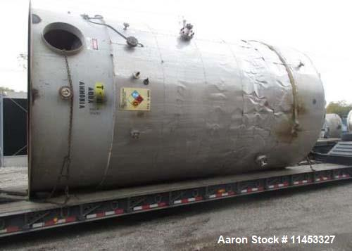 "Used- 12,000 Gallon Stainless Steel Tank. 12' diameter x 16' straight side. 4' carbon steel skirt, dished ends, 24"" side bot..."