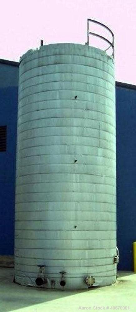 """Used-15,000 Gallon insulated stainless steel tank. 3/8"""" thick 304 stainless steel, 34' tall, 10'6"""" diameter, multiple fill a..."""