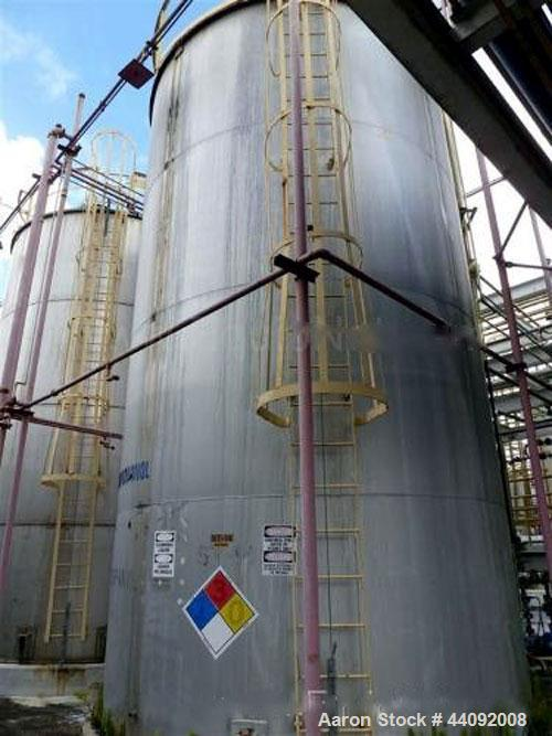 """Used- Alonso & Carus 25,000 Gallon Stainless Steel Vertical Storage Tank. 13'6"""" Nominal Diameter x 24' Nominal Height. Flat ..."""