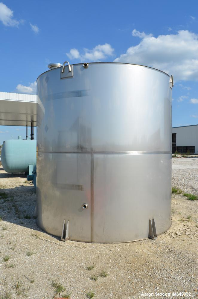 """Unused- 5800 Gallon Storage Tank, stainless steel. Approximate 120"""" diameter x 120"""" straight side, coned top, flat bottom. S..."""