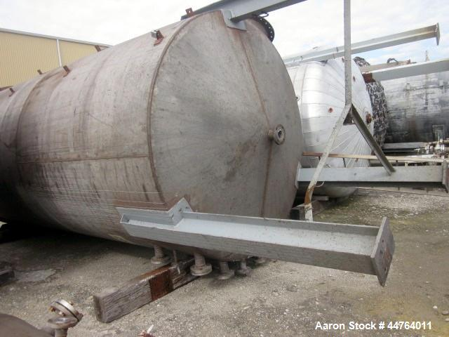 "Used- Tank, 5500 Gallon, 304 Stainless Steel, Vertical. 96"" Diameter x 192"" straight side, flat top, coned bottom. Fixed car..."