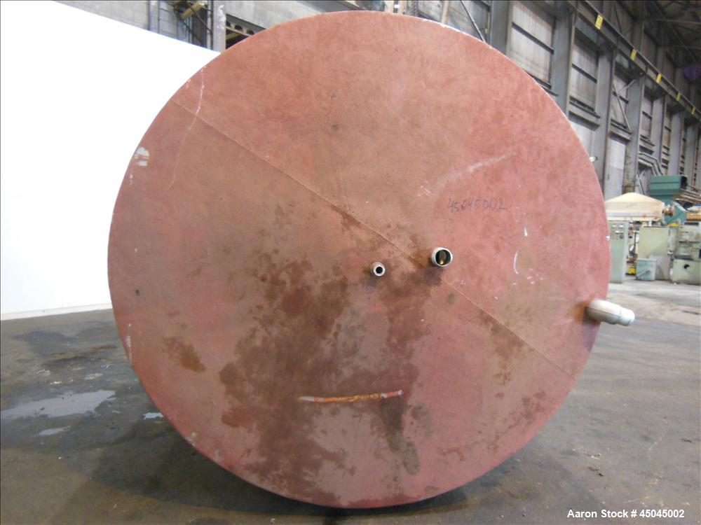 "Used- Tank, 5,000 Gallon, 304 Stainless Steel, Vertical. Approximate 102"" x 142"" straight side, slight coned top, sloped bot..."
