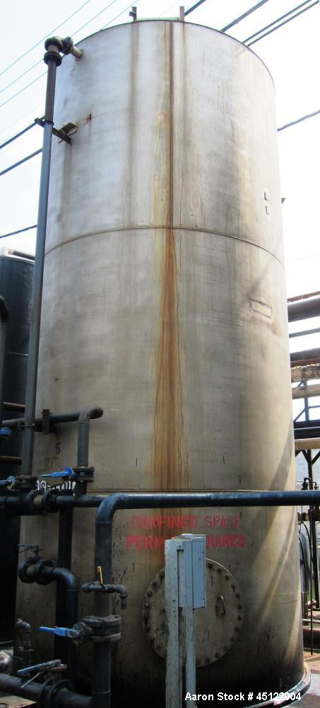 "Used-11,500 Gallon Stainless Steel Storage Tank, 9'6"" diameter, 22' tall, flat top, flat bottom, side entering manway."