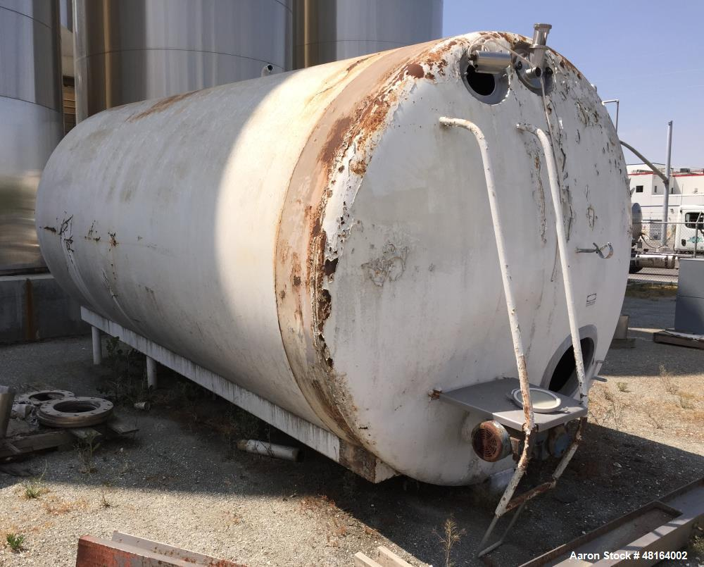 "Used- Tank, 6,000 Gallon, Stainless Steel, Horizontal. Approximate 108"" diameter x 196"" straights side, dished heads. Side e..."