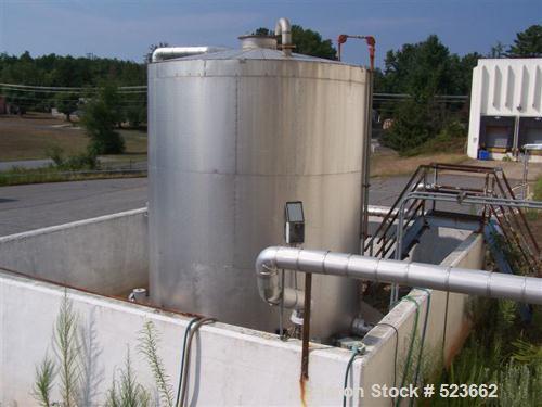 USED: 7500 gallon, 304 stainless steel, vertical tank. Slight dishtop, flat bottom, 10' diameter x 13' overall height, insul...