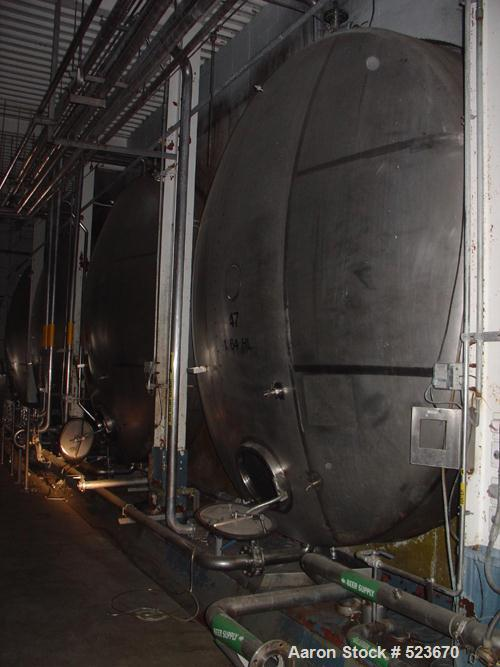 """USED: Tank, 55,957 gallon, 304 stainless steel. 13'3"""" diameter xapproximately 54' long. Horizontal on carbon steel cradle fr..."""