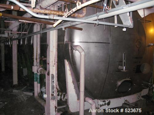 """USED: Tank, 50,330 gallon, 304 stainless steel. 13'3"""" diameter xapproximately 48' long. Horizontal on carbon steel cradle fr..."""