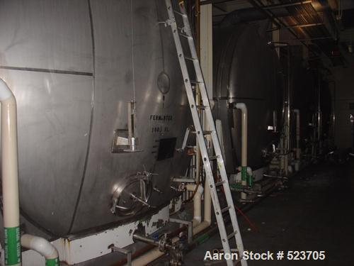 """USED: Tank, 42,748 gallon, 304 stainless steel. 13'3"""" diameter xapproximately 41' long. Horizontal on carbon steel cradle fr..."""