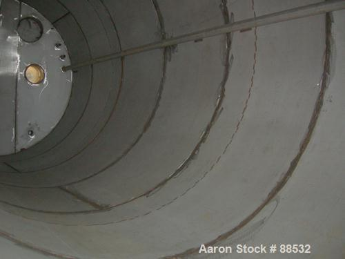 """USED: Tank, 17,800 gallon, 316 stainless steel. Approximate 10'6"""" diameter x 27'6"""" straight side. Slight cone top and flat b..."""