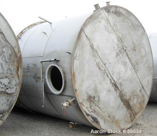 """USED: Tank, 18,000 gallon, stainless steel. Approximate 10'6"""" diameter x 27'6"""" straight side. Slight cone top and flat botto..."""