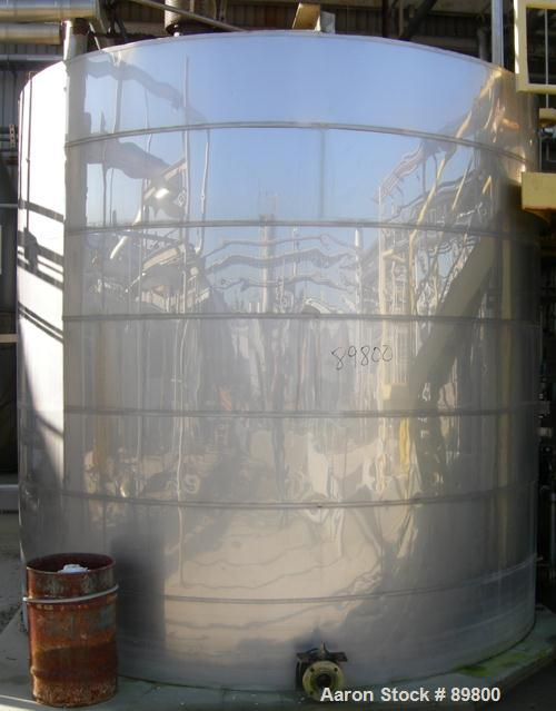 """USED: Approximate 6,000 gallon stainless steel storage tank. Flat top and bottom. 10' diameter x 10' straight side. 3"""" side ..."""