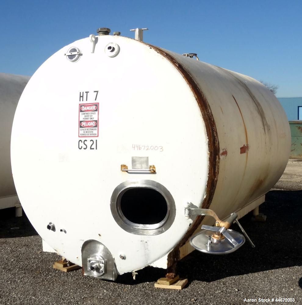 """Used- C.E. Howard Storage Tank, 5000 Gallon, Style 477-A, 304 Stainless Steel, Horizontal. Approximately 96"""" diameter x 150""""..."""
