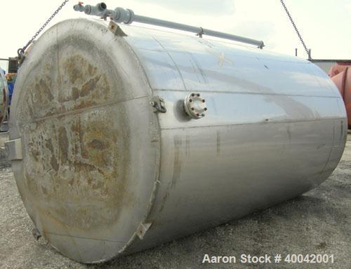 "Used: C.E. Howard Tank, 5000 Gallon, 304 Stainless Steel, Vertical.  94"" diameter x 165"" straight side.  Dish top, flat bott..."