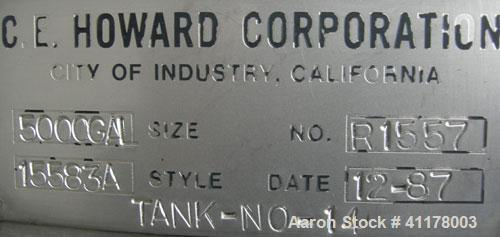 "Used C.E. Howard Tank, 5000 Gallon, 304 Stainless Steel, Vertical. 94"" diameter x 165"" straight side, dish top, sloped botto..."