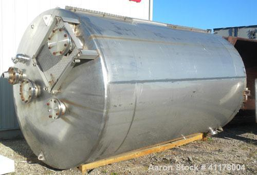 "Used-Used C.E. Howard Tank, 5000 Gallon, 304 Stainless Steel, Vertical. 94"" diameter x 165"" straight side, dish top, sloped ..."