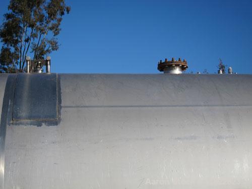 "Used- Cherry Burrell 10,000 Gallon Stainless Steel Horizontal Storage Tank. Approximately 10'6"" diameter x 14'6"" straight si..."