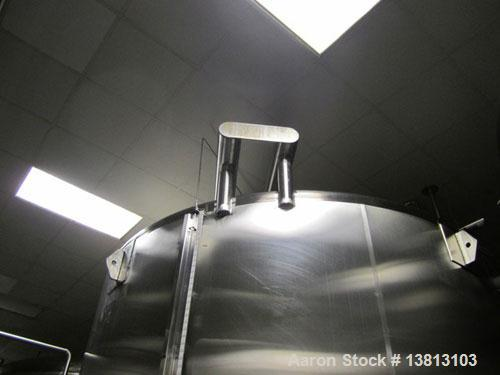 Used-Cherry Burrell 8000 Gallon Vertical Stainless Steel Tank.Top mounted agitator, dual impeller, bearing block, side manwa...