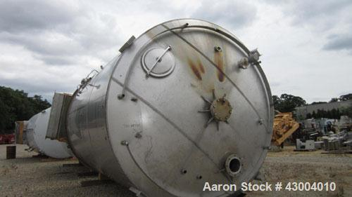 "Used- Cherry-Burrell Tank, 7500 Gallon, Stainless Steel, Vertical. Approximate 128"" diameter x 13' straight side, dished top..."