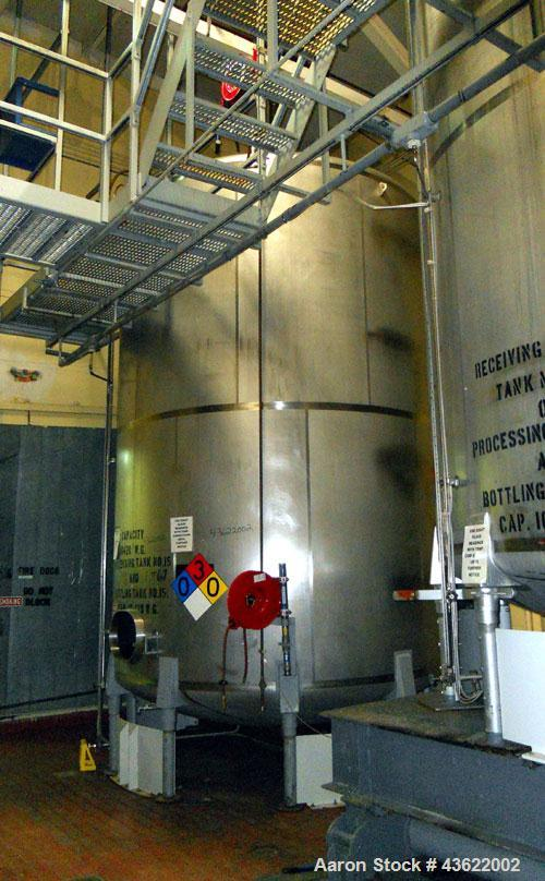 "Used- Cherry Burrell 10,000 gallon stainless steel storage tank. Approx. 10'6"" diameter x 14' straight side. Dished heads. S..."