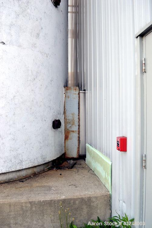 """Used- DCI Jacketed Silo, 3341 Cubic Feet (25,000 Gallon), Stainless Steel. Approximate 144"""" Diameter x 35' tall. Dished top,..."""