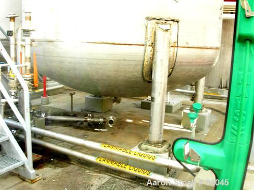 USED: Fabricated Products tank, 9000 gallon, 316L stainless steel, vertical. Approximately 10' diameter x 14' straight side,...