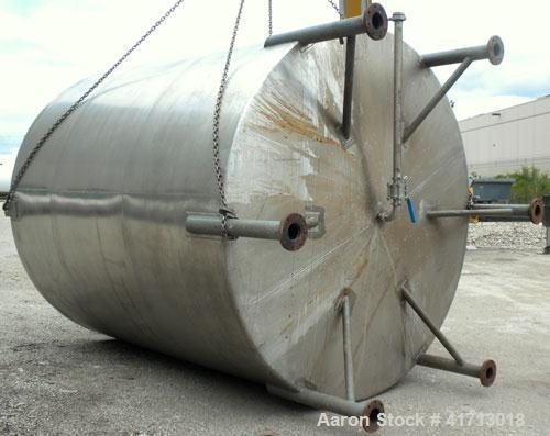 "Used- Filpaco Industries Tank, 6,000 Gallon, 304 Stainless Steel, Vertical.  Approximate 114"" diameter x 132"" straight side,..."