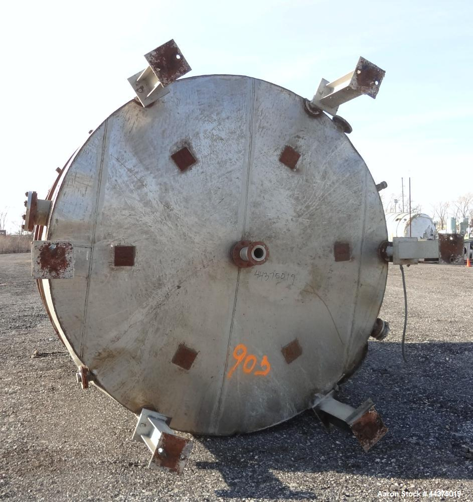 "Used- Tank, 10,500 Gallon, 304 Stainless Steel, Vertical. Approximate 126"" diameter x 192"" straight side, flat welded top, s..."