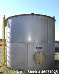 "Used- Tank, Approximate 8500 Gallon, Stainless Steel, Vertical. Approximate 144"" Diameter x 120"" straight side, coned top, f..."