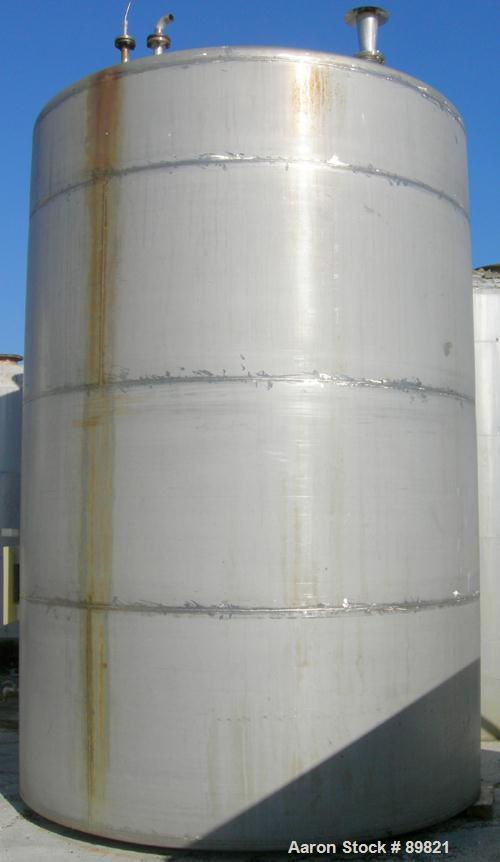 USED: Metal Equipment tank, approximately 8,000 gallons, stainless steel. 10' diameter x 14' straight side. Dish top, flat b...