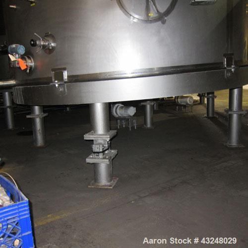 """Used- Mueller Tank, 6000 Gallon, Model DF, 304 Stainless Steel, Vertical. Approximate 118"""" diameter x 126"""" straight side. Of..."""