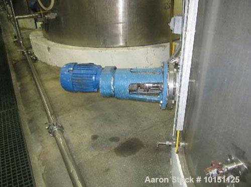 "Used-Approximately 12,500 gallon vertical stainless steel tank.12'6"" diameter x 14'11"" straight side.With Lightnin 3 hp bott..."