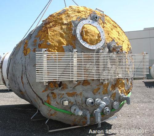 """Used- Stainless Metals Inc Tank, 8800 Gallon, 304L Stainless Steel, Vertical. Approximate 120"""" diameter x 180"""" straight side..."""