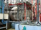 Used- Tank, Approximately 6342 Gallon (24,000 liter), Stainless Steel, Horizontal. Mounted on carbon steel saddles.