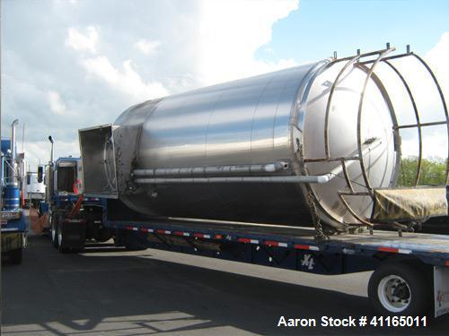 Used- 8,000 Gallon, Walker Vertical Refrigerated Stainless Steel Silo Tank. Stainless exterior, 60 square foot heat transfer...