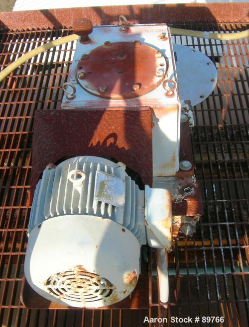 USED: Walker 16,000 gallon, type 316L stainless steel, storage/mix tank. Vertical, dished heads. Approximate 12' diameter x ...