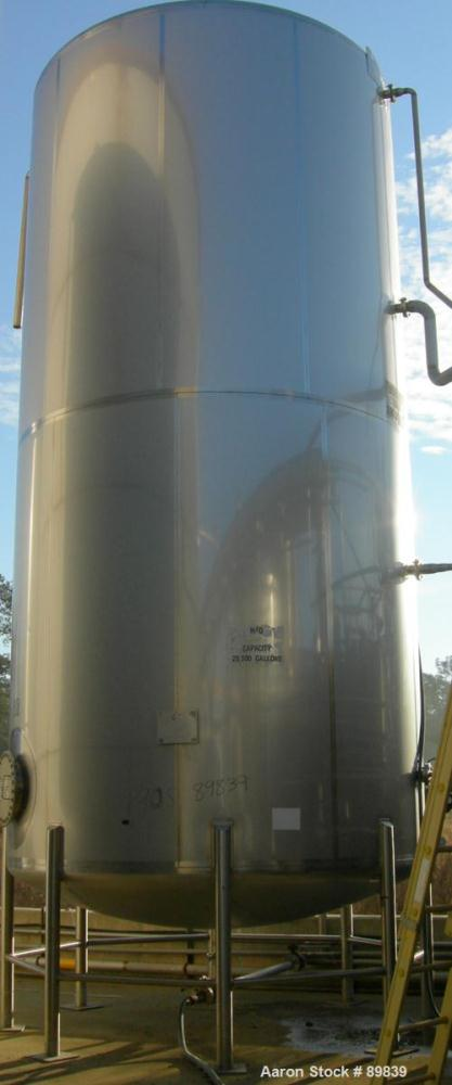 USED: Walker 21,000 gallon, type 304L stainless steel, storage tank. Vertical, dished heads. Approximate 12' diameter x 24' ...